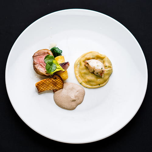 Butter Roasted Lamb Loin with Roasted Matsutake Mushrooms, Confit Rutabaga, Shallots, Spinach and Lobster Ravioli