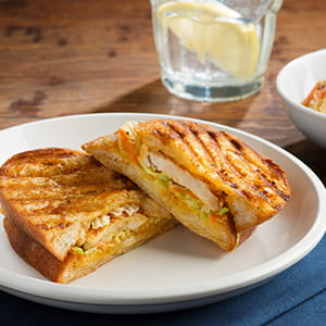 Grilled Chipotle Mango Chicken Panini with Coleslaw and 3 Cheese Crunch
