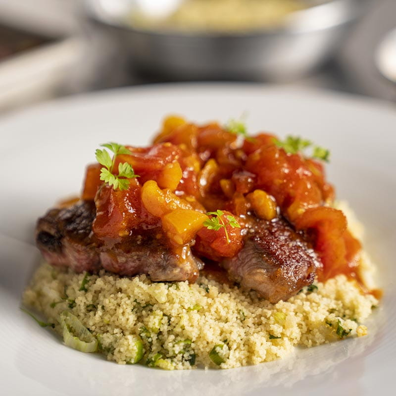 Pan Fried Lamb with Couscous and Tomato and Turmeric Chutney