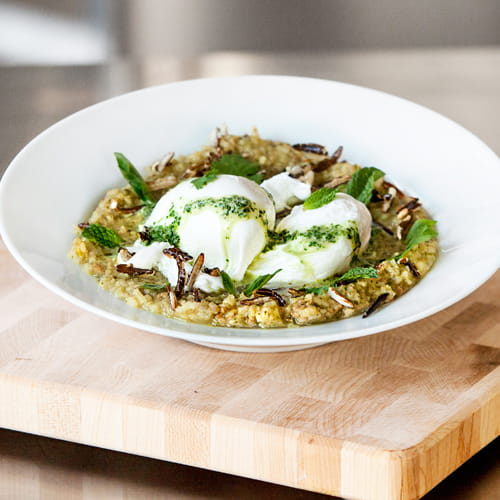 Thai Green Curry Congee with Thai Sausage, Poached Eggs and Puffed Rice